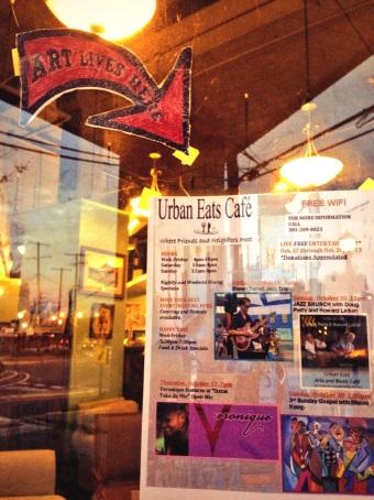 Art Lives Here arrow from Better Block Night in May still on Urban Eats door