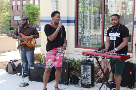 Tamara Wellons Performs in front of beauty shops during Beauty Built on Love