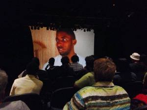 A TTP participant on screen talks about how he handles anger and aggression during the showcase